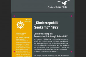 Infostele zur Kinderrepublik Seekamp 1927. Unsere Losung ist: Freundschaft! Ordnung! Solidarität!