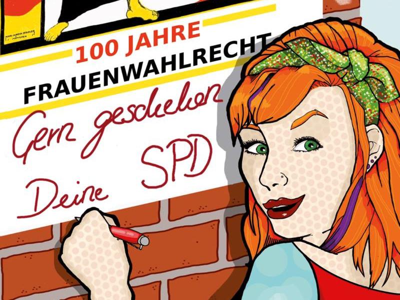 """Ein Mächen schreibt """"Gern geschehen Deine SPD"""" auf ein Plakat zu 100 Jahre Frauenwahlrecht."""
