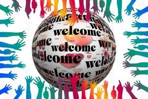 Hände und Schriftzug Welcome