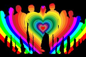 Symbolbild Diversität. Ein Herz in Regenbogenfarben umfasst unterschiedliche Menschen.
