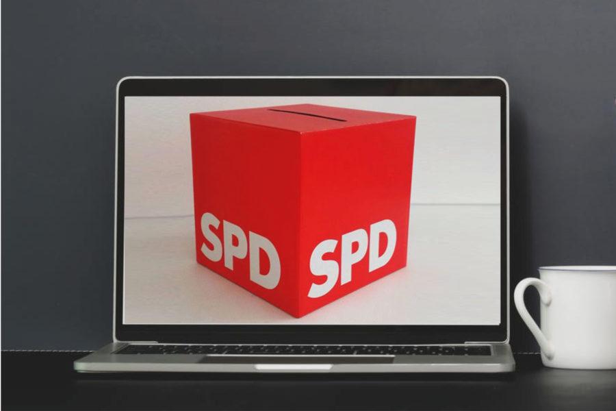 Rote SPD-Wahlurne auf einem -Laptop-Monitor